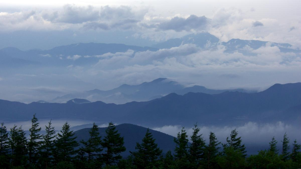 Breathtaking landscape in Japan: Cloudy mountains seen from Mount Fuji.