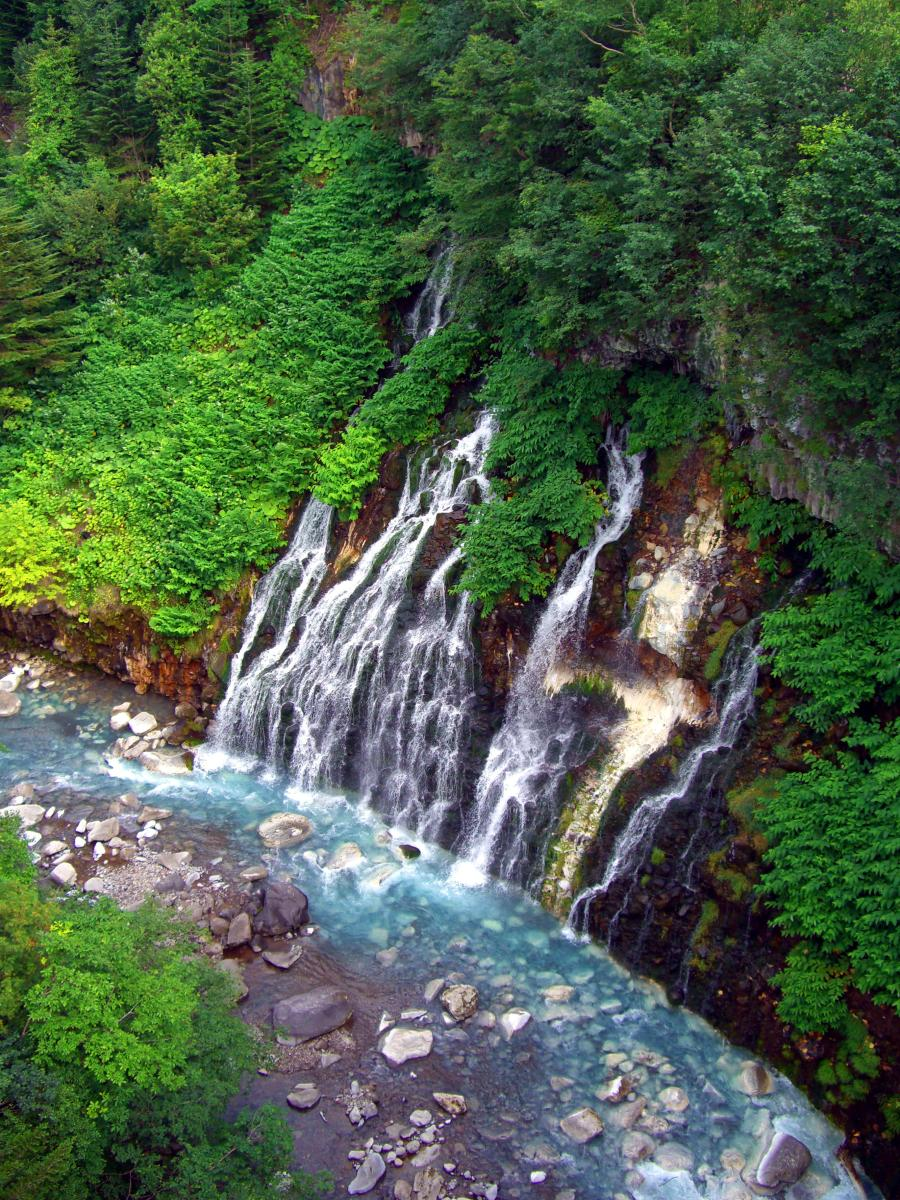 Gorgeous landscape in Japan: Waterfalls and river near Mount Tokachi (Hokkaido).