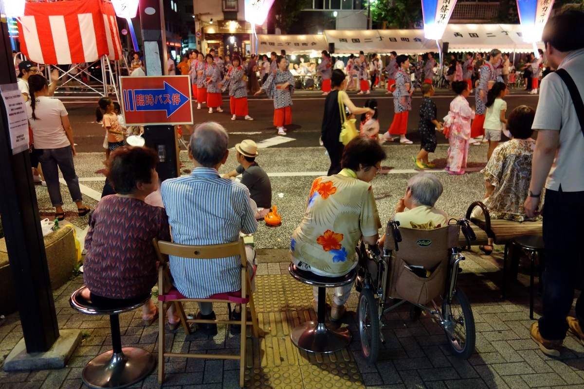 Yukata De Guide Tour: Elders watching a Bon-odori dance in 墨田区 (Sumida ward, Tokyo, Japan) on 02 August 2014.